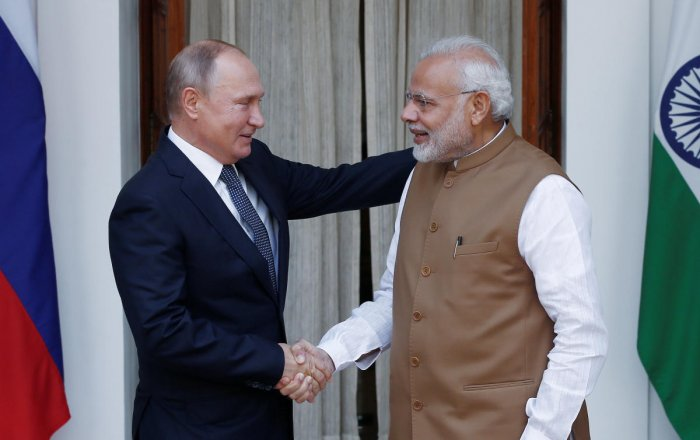 Russian President Vladimir Putin shakes hands with Prime Minister Narendra Modi ahead of their meeting at Hyderabad House in New Delhi, on October 5, 2018. REUTERS