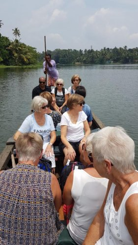 A group of Norwegian tourists on a backwater trip in Kerala