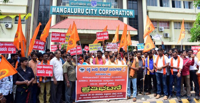 VHP activists stage a protest against the modernisation of Kudroli abattoir, outside the city corporation office building in Mangaluru on Friday.