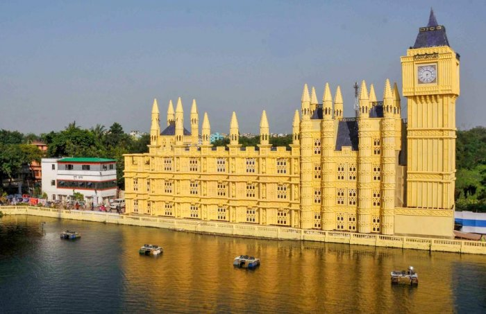 A view of Durga puja pandal made as a replica of 'Palace of Westminster with Big Ben' during Durga Puja festival, in Kolkata, Tuesday, Oct 16, 2018. (PTI Photo)