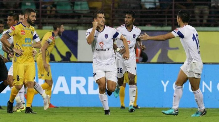 Delhi's Kaluderovic (left) celebrates after scoring. ISL