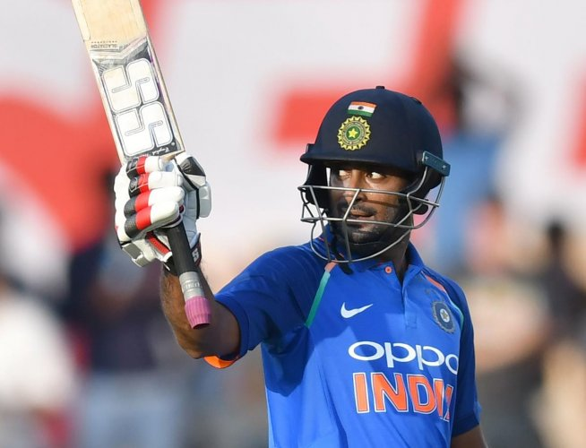 Ambati Rayudu celebrates after reaching his ton during the fourth ODI against the West Indies in Mumbai on Monday. AFP
