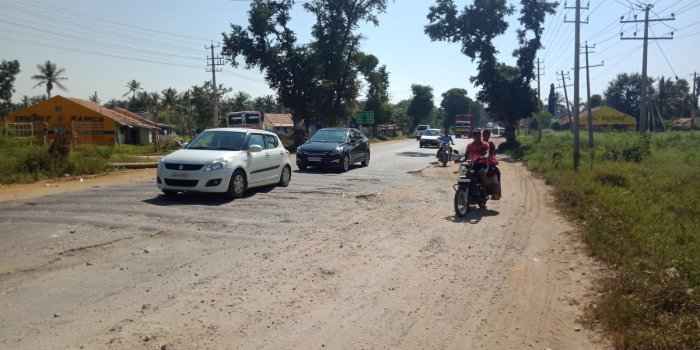 Pothole-filled humps on the National Highway 206 in Kadur.