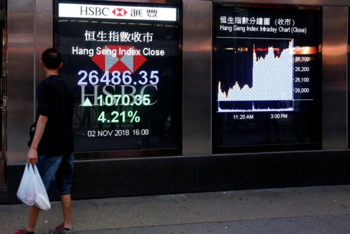 A panel displays the closing Hang Seng Index outside a bank in Hong Kong, China. Reuters file photo.