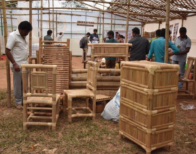 Visitors at a stall with bamboo products at the Krishi Mela.