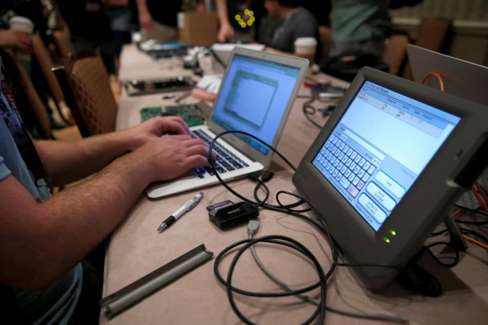 FILE PHOTO: A hacker tries to access and alter data from an electronic poll book in a Voting Machine Hacking Village during the Def Con hacker convention in Las Vegas, Nevada, U.S. on July 29, 2017. REUTERS/Steve Marcus/File Photo