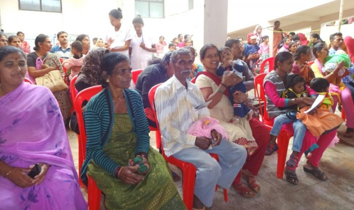 Parents and guardians take part in the inaugural function of Newborn Children's Week at the district hospital in Madikeri.