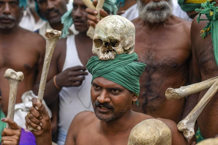 A farmer from Tamil Nadu display human skulls and bones during a protest ahead of their march towards Parliament, at Ramlila Maidan in New Delhi on Nov. 30, 2018. (PTI File Photo)