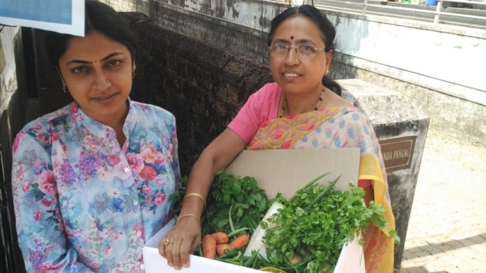 A customer seen with the organic vegetables delivered by the ECO – Friends Group in Mangaluru.