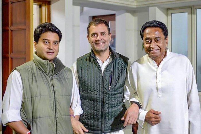 Congress President Rahul Gandhi flanked by Madhya Pradesh Congress leaders Jyotiraditya Scindia (L) and Kamal Nath after a meeting in New Delhi on December 13. PTI