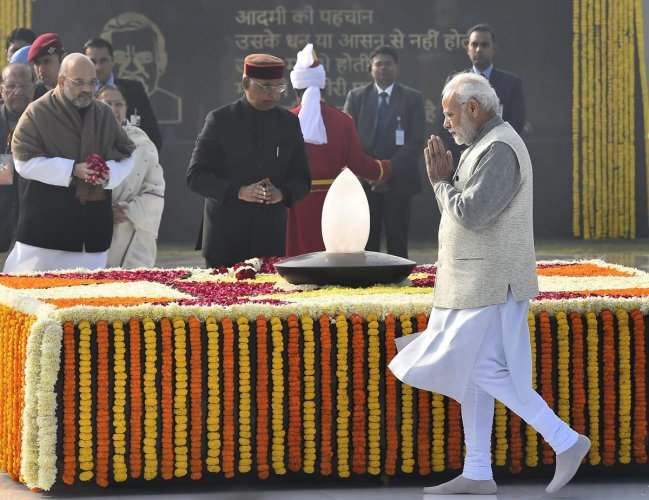 Prime Minister Narendra Modi pays homage to former prime minister late Atal Bihari Vajpayee on the latter's 94th birth anniversary in New Delhi on Tuesday. President Ram Nath Kovind and BJP president Amit Shah are also seen. PTI