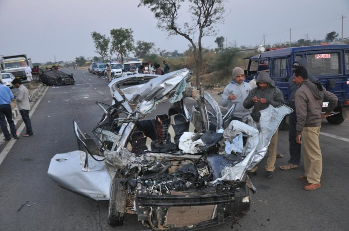 Police inspect the Hyundai i10 car which was split open following a collision with an i20 car near Gadag on Sunday. dh photo