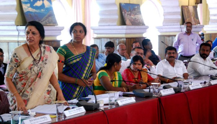Congress members speak during the Zilla Panchayat general meeting in Old Fort Hall in Madikeri on Monday