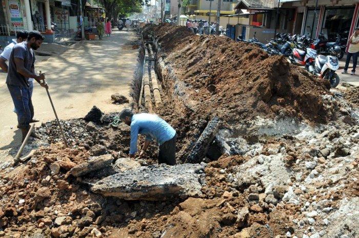 The work on laying drinking water pipeline in progress on Basavanahalli Main Road in Chikkamagaluru.