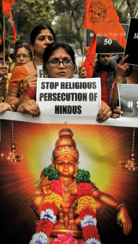 Members of the Hindu Jagran Manch (HJM) participate in a march 'Walk for Ayyappa' in relation to violence faced by devotees at Sabarimala's Ayyappa temple, in Kolkata. PTI