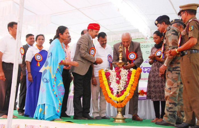 Retired Air Marshal K C Cariappa inaugurates the 120th birth anniversary celebrations of Field Marshal K M Cariappa, organised by the district administration, Zilla Panchayat and Kannada and Culture Department, on Old Fort premises in Madikeri on Monday.