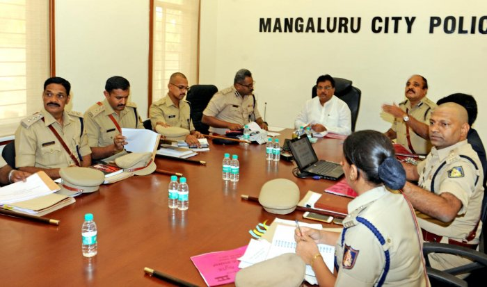 Home Minister M B Patil takes part in a meeting of senior police officers in Mangaluru on Monday.