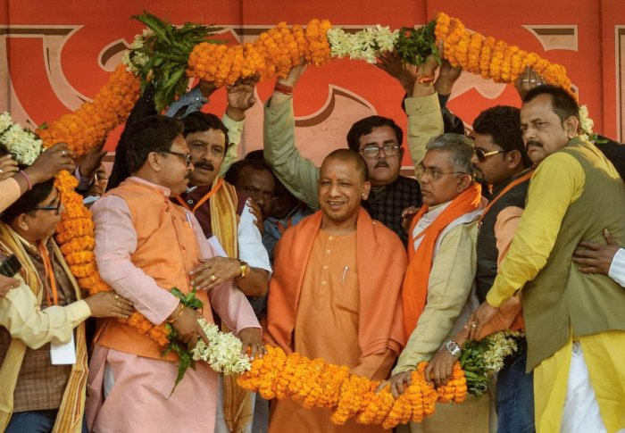 BJP sources told DH that party workers are apprehensive that putting up stickers and party flag at their homes may result in the homes getting attacked by Trinamool Congress cadres. PTI FIle Photo