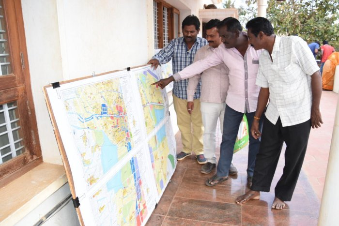 Citizens look at a master plan in Davangere.