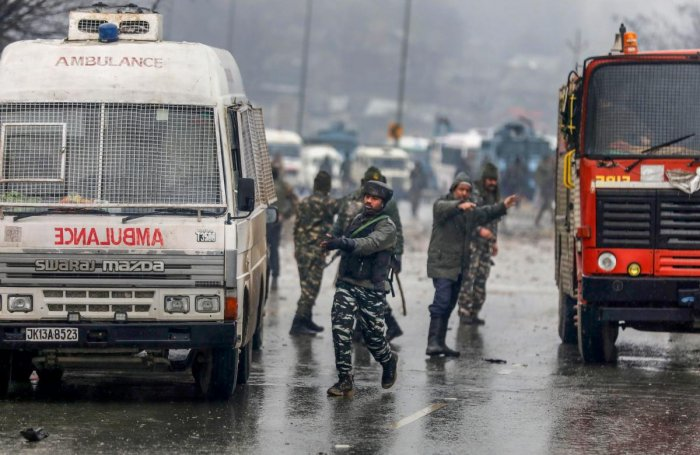 Army soldiers at the site of suicide bomb attack at Lathepora Awantipora in Pulwama district of south Kashmir, Thursday, February 14, 2019. At least 30 CRPF jawans were killed and dozens other injured when a CRPF convoy was attacked. (PTI Photo)