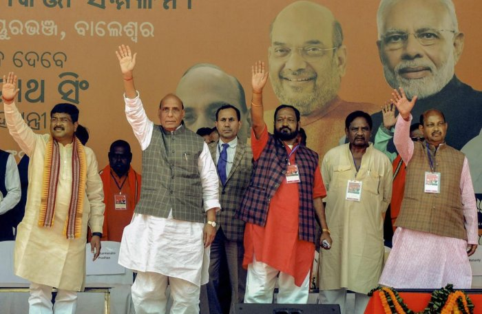 Union Home Minister Rajnath Singh, Union PNG Minister Dharmendra Pradhan, state BJP President Basanta Panda and others during booth- level workers conference meeting and public rally, in Bhadrak, Sunday, Feb 17, 2019. (PTI Photo)