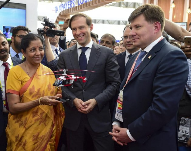 In one of the first business, deals struck at Aero India 2019, the Russian Helicopters Holding Company (a part of State Corporation Rostec) and a number of Indian companies signed Memorandums of Understanding. In photo: Union Defence Minister Nirmala Seetharaman receives a miniature helicopter as a memento from Russian stall after inauguration of the 12th edition of 'AERO India 2019' at Yelahanka Air Base, in Bengaluru, Wednesday, Feb 20, 2019. PTI photo.