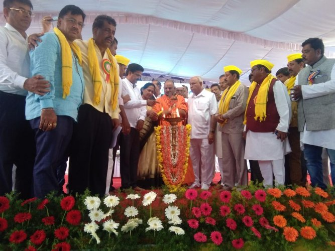 Opposition leader in the Assembly, B S Yeddyurappa, and others on the second day of the state-level Devanga Nekara community convention held in Tarikere on Tuesday.