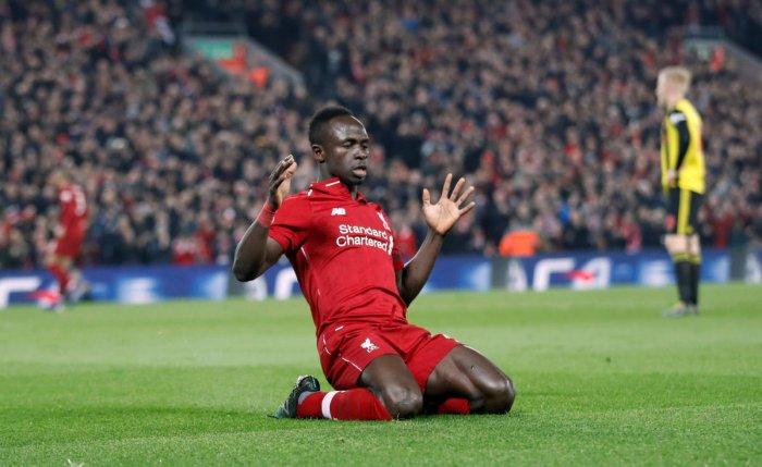 Liverpool's Sadio Mane celebrates scoring their first goal against Watford. REUTERS