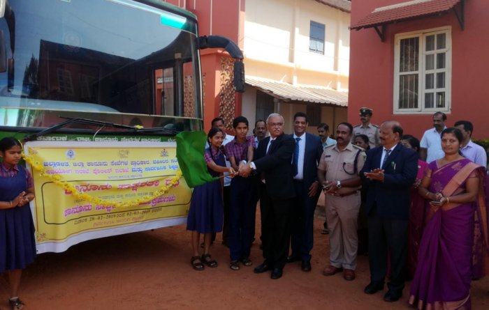 Principal District and Sessions Judge C M Joshi flags off the Legal Literacy Chariot on the premises of district court in Udupi on Thursday.