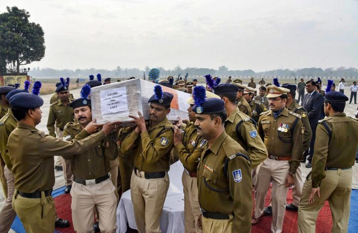 CRPF personnel carry the mortal remains of inspector Pintu Kumar Singh, who was killed in an encounter with militants at north Kashmir's frontier Kupwara district, after a wreath-laying ceremony, in Patna. (PTI Photo)