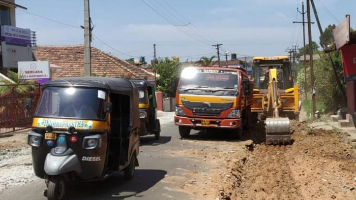 Widening work in progress on the road leading to the new private bus stand in Madikeri.