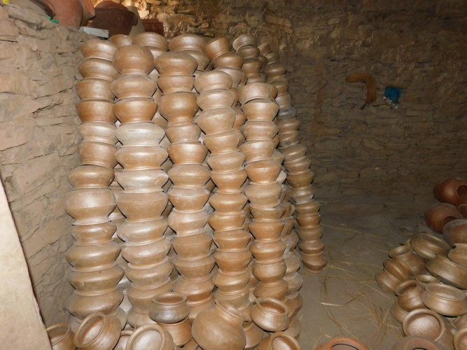 earthenware: Pots ready for sale at Mugad, a village near Dharwad, which is traditionally known for pottery; potter Shekhappa at work. photos by author