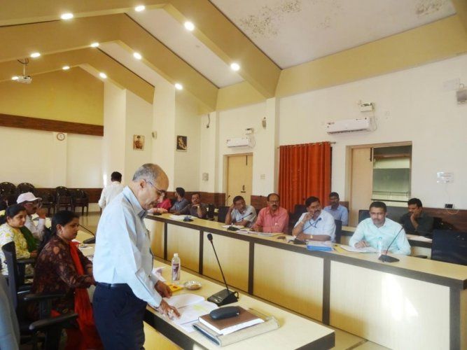Regional Transport Officer Gangadhar speaks during the road safety meeting at the DC's office in Madikeri.