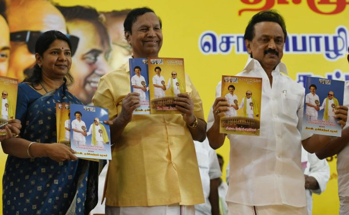 DMK party chief M K Stalin, DMK principal secretary T R Balu (C) and DMK women's wing secretary M Kanimozhi, hold the party's manifesto during its release for the forthcoming general election at the party's headquarters in Chennai on Tuesday. AFP