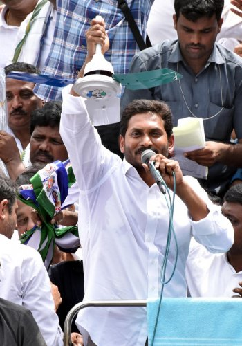 Jagan in campaign photo with party symbol fan