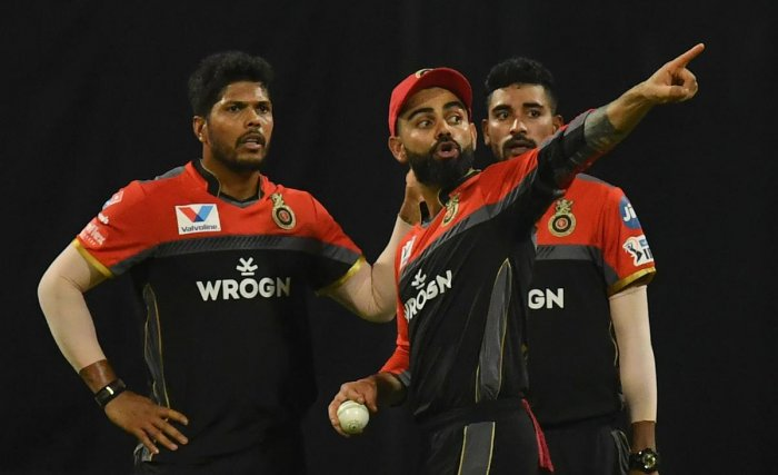 POOR SHOW: The pace duo of Umesh Yadav (left) and Mohammed Siraj (right) have failed to deliver for RCB this season. AFP File Photo