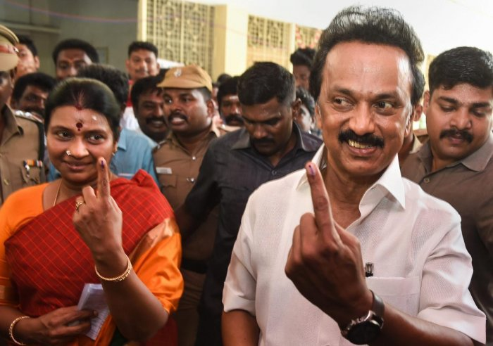 DMK President MK Stalin and his wife Durga Stalin show their finger marked with indelible ink after casting vote for the second phase of the general elections, at a polling station in Chennai, Thursday, April 18, 2019. (PTI Photo)