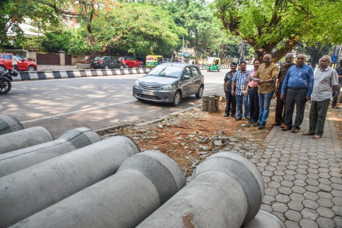 (From left) S Manjunath, Mallikarjun, A C Chandrashekar, Dr Kiran Kumar, R V Nagaraj, G S Bhaskar and Jayashekar Yale are the residents of Jayanagar and Basavanagudi, who have filed a PIL against the unscientific way in which the white-topping work is being done. They contend that there is no need for white-topping as the road is in perfect condition.