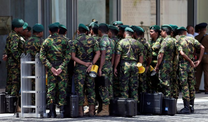 """""""A curfew will be imposed until things settle down,"""" he told reporters in Colombo. Reuters photo"""