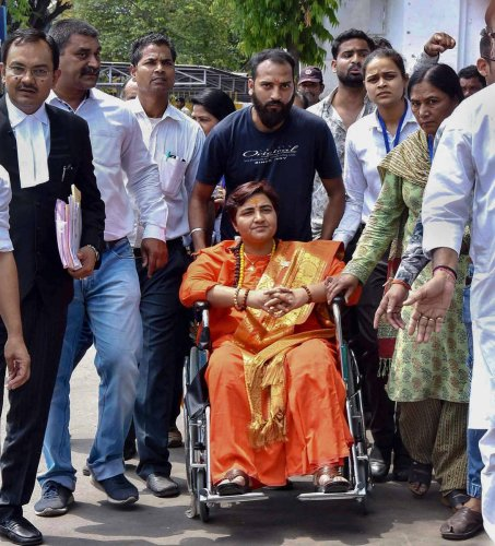 BJP candidate for Bhopal Lok Sabha constituency Sadhvi Pragya Singh Thakur arrives at district collectorate office to collect nomination papers, in Bhopal on April 22, 2019. PTI