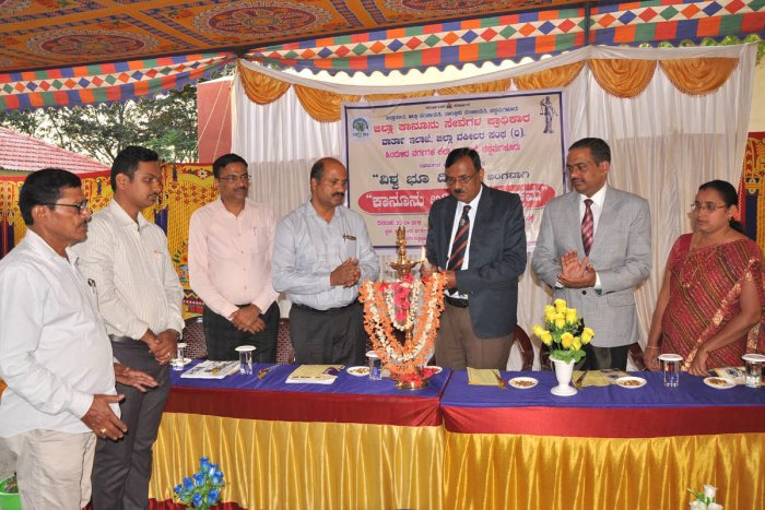Labour Court Judge A S Sadalage inaugurates the World Earth Day and Legal Awareness programme in Chikkamagaluru.