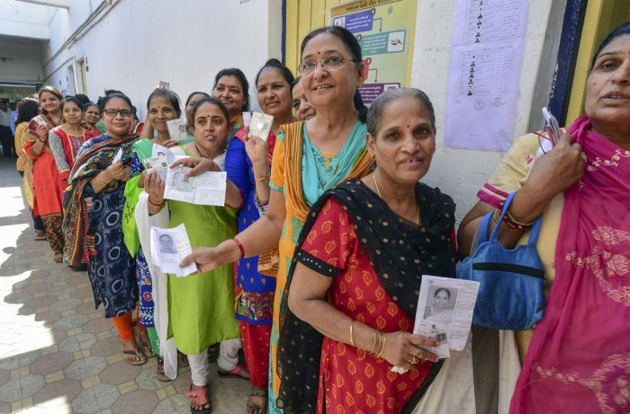 Ahmedabad: Women voters queue up to cast their votes at a polling station, during the third phase of the 2019 Lok Sabha polls, in Ahmedabad, Tuesday, April 23, 2019. (PTI Photo/Santosh Hirlekar) (PTI4_23_2019_000250B)