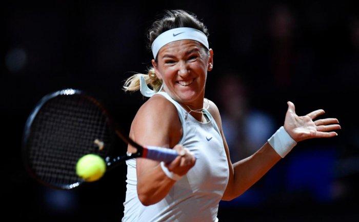 FIERCE: Belarus' Victoria Azarenka returns during her win over Russia's Vera Zvonereva. AFP