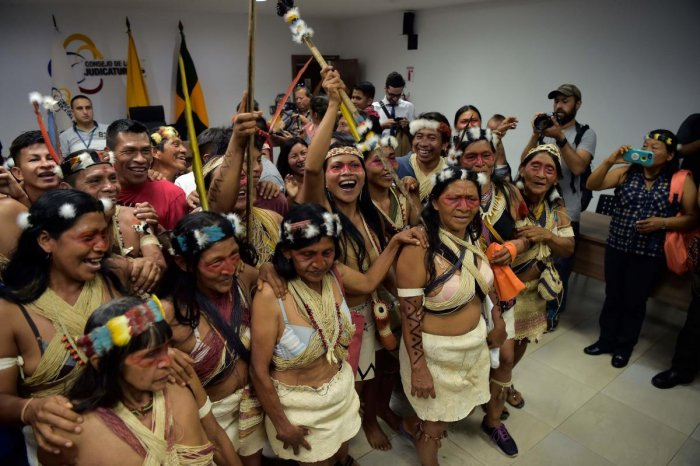 Waorani indigenous people celebrate after a court ruled in their favour on the tribe's legal challenge to the government's land selloff, at the end of the protection action hearing in Puyo, Ecuador, on April 26, 2019. (AFP)