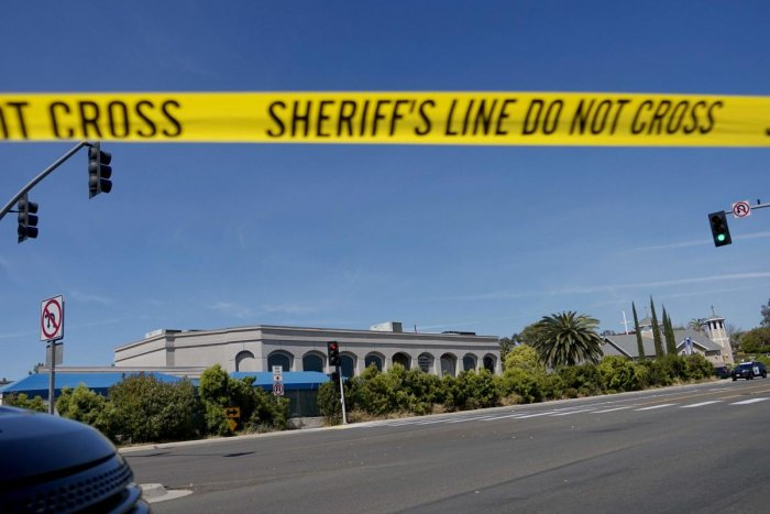 TOPSHOT - Sheriff's crime scene tape is placed in front of the Chabad of Poway Synagogue after a shooting on Saturday, April 27, 2019 in Poway, California. - A gunman opened fire at a synagogue in California, killing one person and injuring three others i