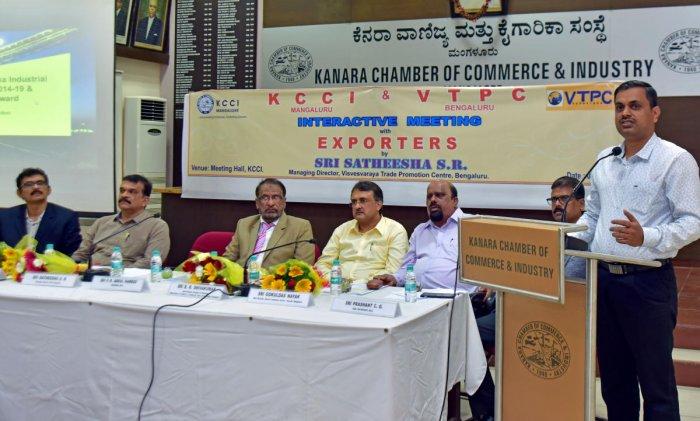Visvesvaraya Trade Promotion Centre (Bengaluru) Managing Director Satheesha speaks at an interactive meeting with exporters at KCCI Hall in Mangaluru on Friday.