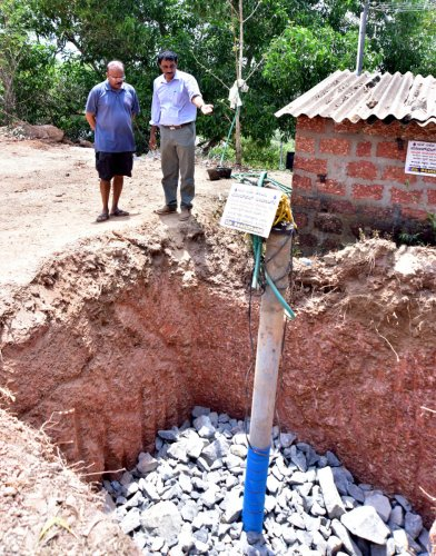 Hydrogeologist and rainwater harvesting consultant N J Devaraja Reddy explains borewell recharge method to research scientist Kiran Kumar Shetty at Pavoor, on the outskirts of Mangaluru.