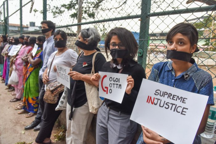 Women gag themselves during a protest in the city on Tuesday against the clean chit given to the Chief Justice of India, Ranjan Gogoi. DH PHOTO/S K DINESH