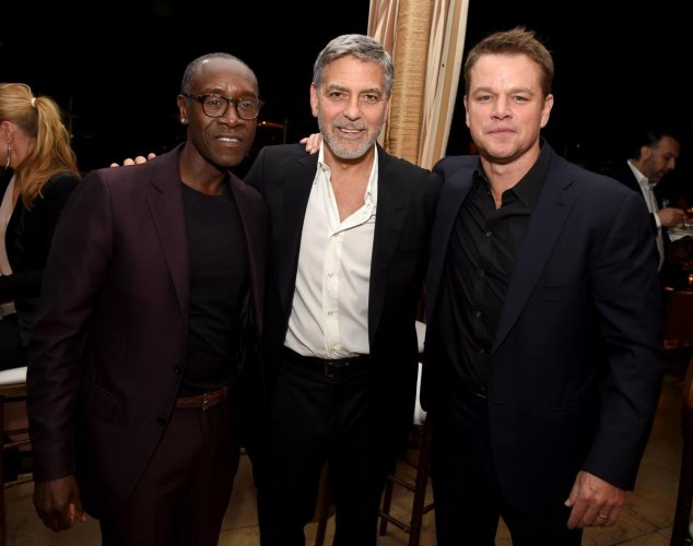 "Don Cheadle, George Clooney and Matt Damon pose at the after party for the premiere of Hulu's ""Catch-22"" at the Sunset Towers on May 07, 2019 in West Hollywood, California. AFP"