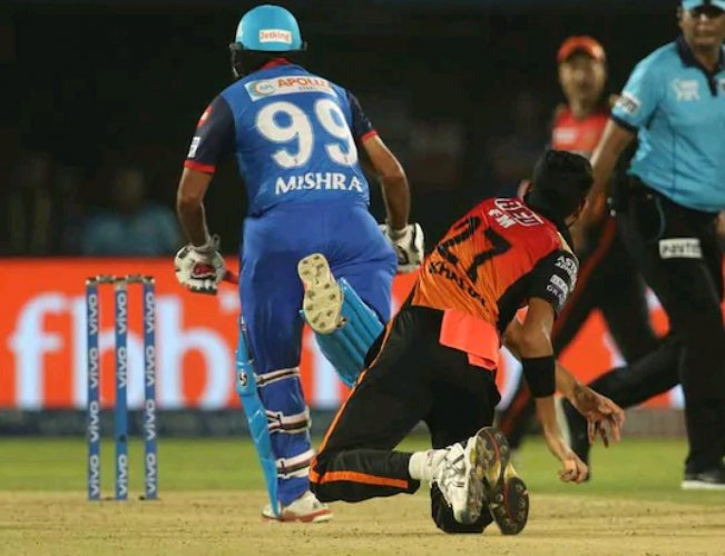 NOT ALLOWED: Delhi Captials' Amit Mishra obstructs the field as SRH pacer Khaleel Ahmed attempts a hit at the stumps.